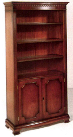 Gothic bookcase with lower doors. Mahagony or yew.