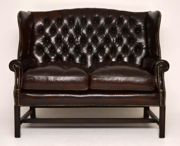 Antikes tiefgeknöpfte Leder Ohren-Sofa